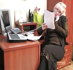 Hot office sex with a MILF and a young guy