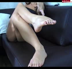 Husband worships her wife's feet